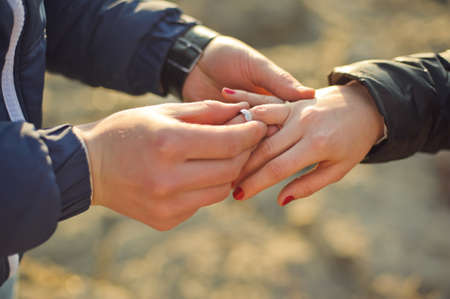 The Man Wears A Wedding Ring On Womans Hand Stock Photo Picture