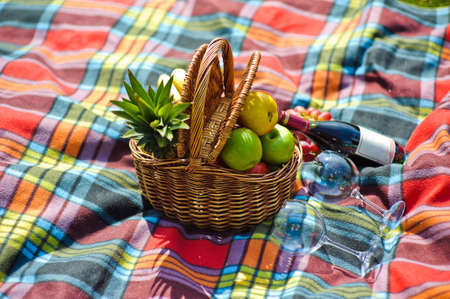 nick: A fruit basket, a bottle of wine and two glasses