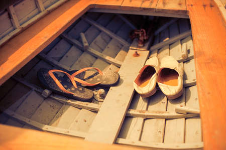 deepsea: Mens and womens shoes in the boat