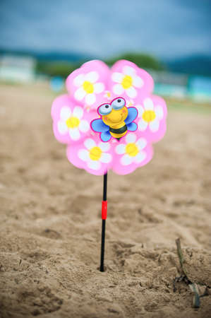 grand strand: Weather vane - flower on the beach turns Stock Photo