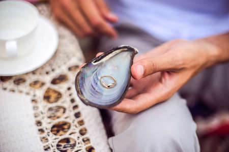 Shell with engagement ring inside, will you marry me Stock Photo