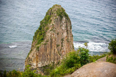 cusp: High acute Cliff by the sea, waves