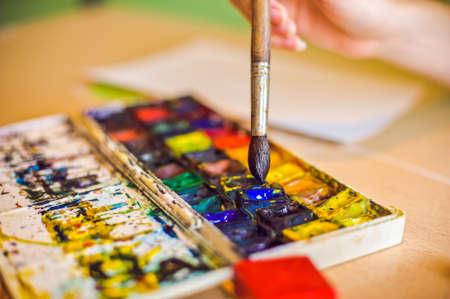gaining: Brush taps in blue paint, gaining paint, watercolor