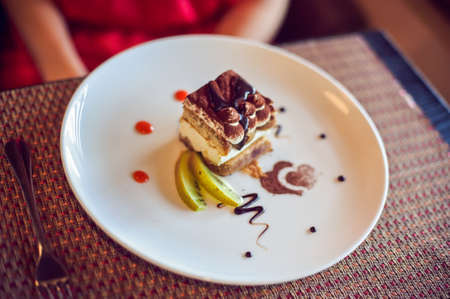 Cake on a plate in a cafe Stock Photo