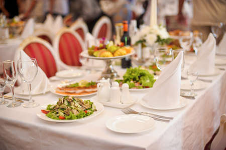 meal time: A table with a white tablecloth setting and decoration for meal time