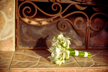 Beautiful bouquet of lily of the bride on the mantelpiece