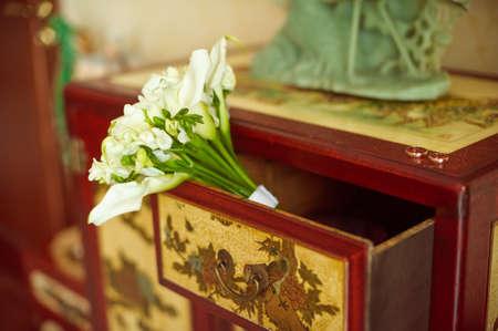 dresser: Wedding bouquet of lilies on the dresser