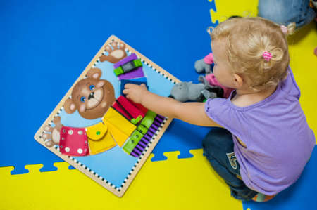 Toddler girl playing in developing the game, early development