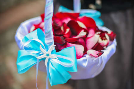 Basket with rose petals, and blue bows