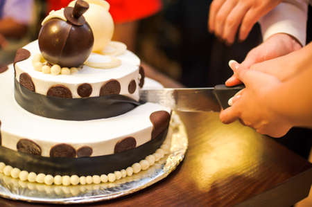 Brown and white cake with chocolate and glaze Stock Photo