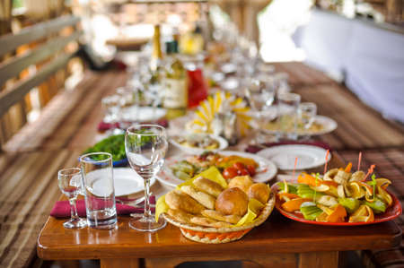wooden table covered with a rustic meal
