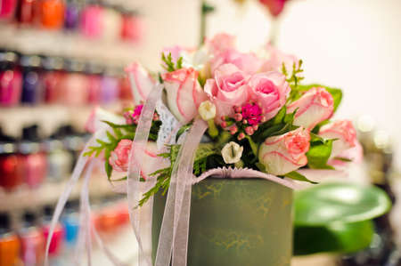 Bouquet of pink roses and ribbons in a beauty salon Stock Photo