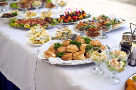 huge: Catering service. Restaurant table with food. Huge amount of food on the table. Plates of food. Dinner time, lunch.