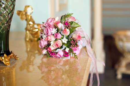 Bouquet of small pink roses on the mantel