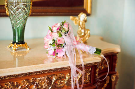 mantel: Bouquet of small pink roses on the mantel
