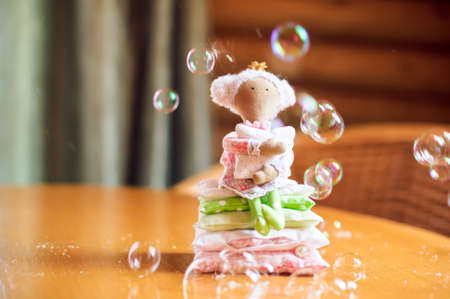 Doll Princess and the pea and soap bubbles