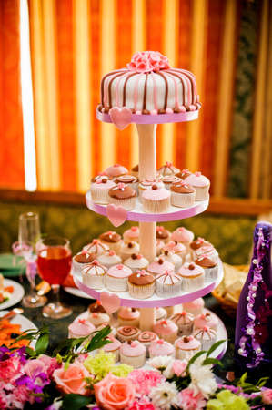 tier: mini cupcakes on a multi level tier pink and brown