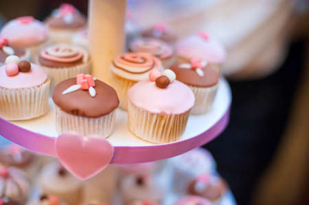 mini cupcakes on a multi level tier pink and brown