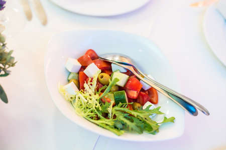 heathy diet: Greek salad with fresh vegetables, feta cheese and olives