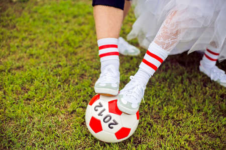 European Football Championship concept. Bride and groom on the football stadium. soccer ball