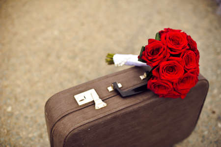 a place for the text: Wedding bouquet on old suitcase. And a place for text