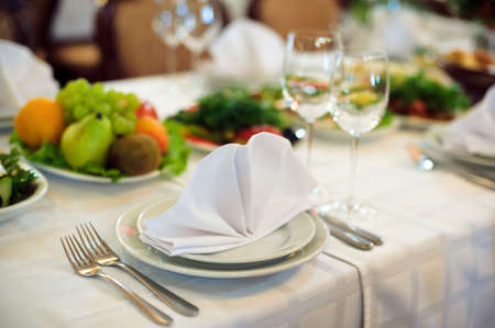 Catering service. Restaurant table with food. Huge amount of food on the table. Plates of food. Dinner time, lunch.