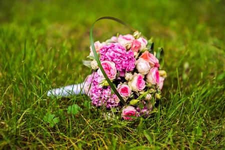 rosa: picture of a wedding bouquet , Wedding bouquet of pink and white roses lying on grass