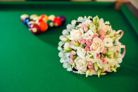 Bridal bouquet on a billiard table green