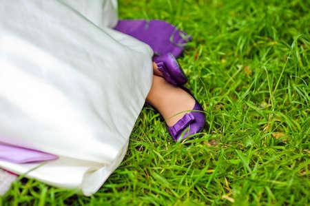 purple shoes: Purple bride shoes on green grass Wedding concept