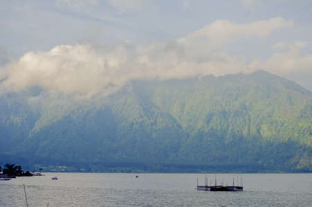 The Batur lake in the central mountains in Bali near the Kintamani village, Indonesia. Stock Photo