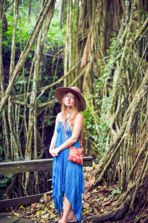 janu: Woman in tropical jungles of Bali, Indonesia