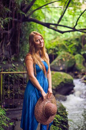janu: Woman in tropical jungles of Bali, Indonesia