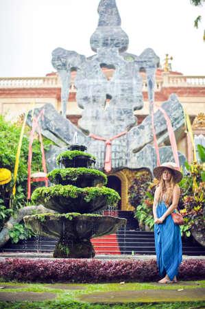 Woman on the background of Antonio Blanco Museum, Bali, Indonesia
