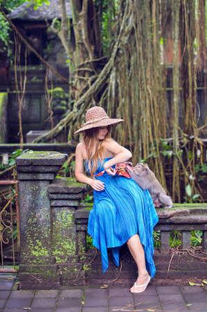 Monkey takes away a womans bag, Bali, Indonesia