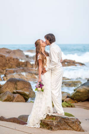 romantic beach: Bride and groom on the tropical beach wedding concept Stock Photo