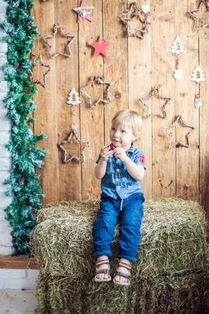 tot: Toddler boy in the Christmas room. Christmas concept