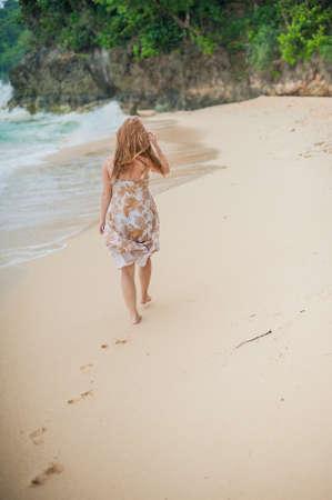 waters edge: The girl walks on the waters edge on the island of Boracay Stock Photo