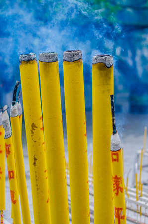 thick incense sticks at a Buddhist temple, Hong Kong