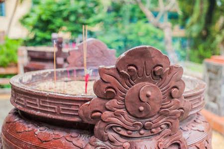 Buddhist prayer sticks inside temple. Incense. Asia Travel concept. Journey through Vietnam Concept.