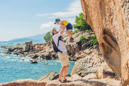 hon: Father and son travelers at the Hon Chong cape, Garden stone, popular tourist destinations at Nha Trang. Vietnam. Asia Travel concept. Journey through Vietnam Concept.
