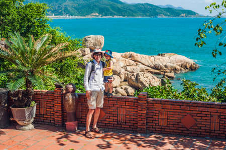 trang: Father and son travelers look at Hon Chong cape, Garden stone, popular tourist destinations at Nha Trang. Vietnam. Asia Travel concept. Journey through Vietnam Concept.