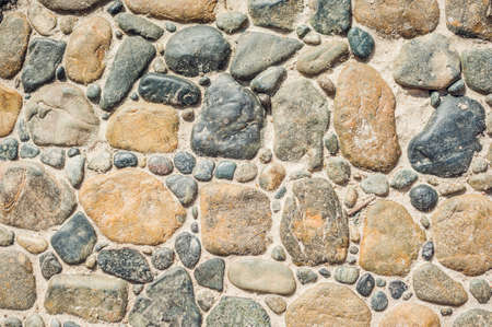 cobblestone street: Paving blocks made of round stones and concrete path. Can be used as texture or background