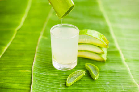 Aloe vera pieces on the background of banana leaf. Organic cosmetics concept. Natural cosmetics concept