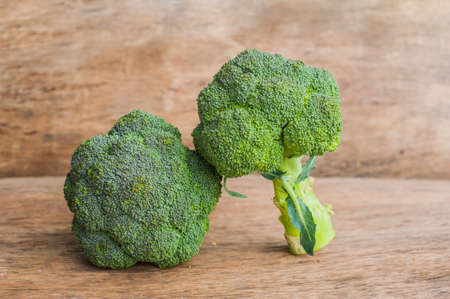 Fresh broccoli on the wooden table. Fresh vegetables concepts. Stock Photo