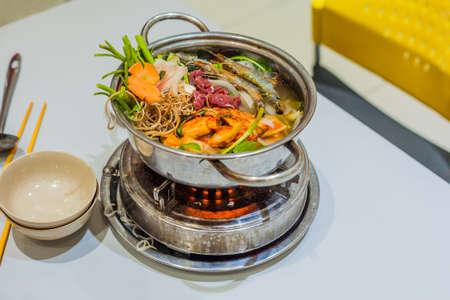 Vietnamese soup hot pot with shrimp, pork and sauerkraut. Vietnamese cuisine concept