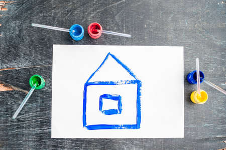 house painter: Childrens drawing of a house painted with colored paints. Home concept.