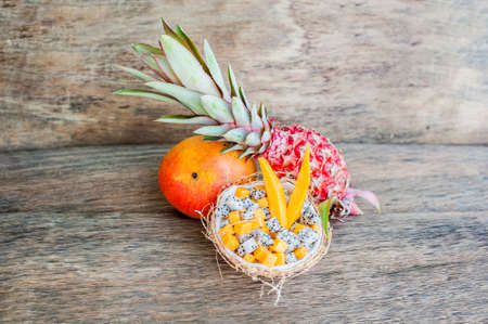 papaya flower: Fruit salad with dragon fruit and papaya in half a coconut. Healthy eating concept. Vegan concept. Tropical fruits concept