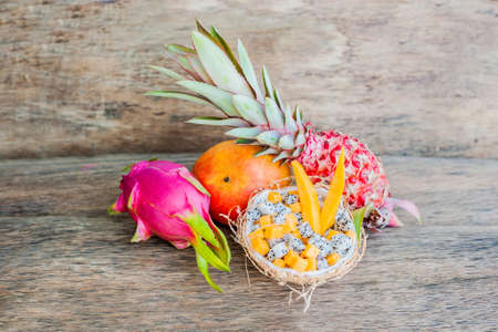Fruit salad with dragon fruit and papaya in half a coconut. Healthy eating concept. Vegan concept. Tropical fruits concept