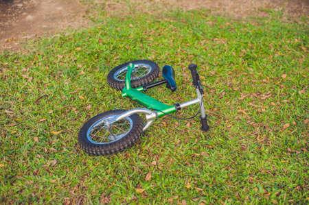 greengrass: Balance bike on green grass. childrens sports concept Stock Photo
