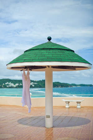 ahorcada: Wedding dress at the hotel on the background of the pool, ocean and mountains.